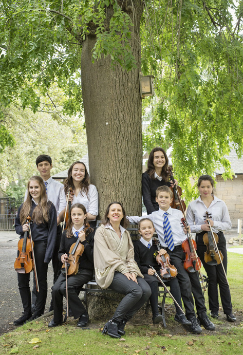 Violin pupils with teacher
